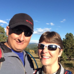 Joe and Colleen on a hike in the mountains